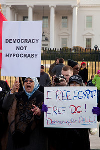 "Several hundred demonstrators demanding that Egyptian President Hosni Mubarak vacate his office gathered outside the White House for a planned march to Capitol Hill in Washington DC on Friday, February 4, 2011. Mubarak has been head of government in Egypt for 30 years. In recent days, thousands of Egyptians have poured into the streets of several cities to call for a change in government. Sign reads ""Democracy Not Hypocracy"". (Photo by Jeff Malet)"
