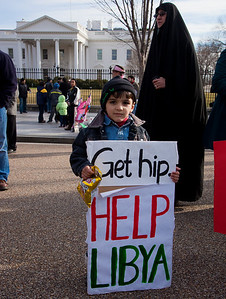 "Three year old Ahmed says ""Get hip, Help Libya"". Hundreds of demonstrators gathered in front of the White House calling on the United States to do more to help liberate Arab nations. The protestors stood in solidarity with pro-democracy movements taking place in Libya, Yemen, Bahrain, Iraq, Iran and the Sudan. In Washington DC on Saturday, February 26, 2011. (Photo by Jeff Malet)"