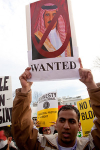 Protestor holds up a wanted poster of Bahrain King Hamad Bin Isa al Khalifa.  Hundreds of demonstrators gathered in front of the White House calling on the United States to do more to help liberate Arab nations. The protestors stood in solidarity with pro-democracy movements taking place in Yemen, Bahrain, Libya, Iraq, Iran and the Sudan. In Washington DC on Saturday, February 26, 2011. (Photo by Jeff Malet)