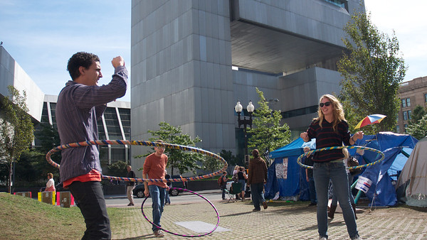 Oct. 7, 2011, Boston, MA - A trio of protesters hula hoop at the Occupy Boston encampment in Dewey Square, one week into the protest's establishment. Photo by Ryan Hutton.