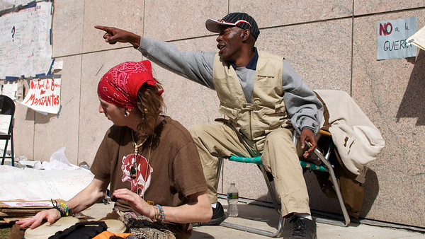 Oct. 7, 2011, Boston, MA - A pair of protesters play the bongos and sing to pedestrians at the Occupy Boston encampment in Dewey Square, one week into the protest's establishment. Photo by Ryan Hutton.