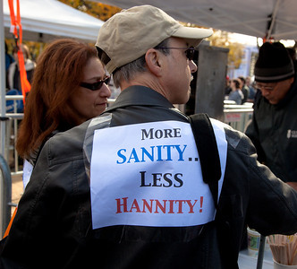 "Imaginative protest signs were ubiquitous among the several hundred thousand who attended a ""Rally to Restore Sanity and/or Fear"" on the National Mall organized by Comedy Central talk show hosts Jon Stewart and Stephen Colbert  in Washington DC on Saturday, October 30, 2010. This one is aimed at Fox News conservative commentator Sean Hannity. (Photo by Jeff Malet)"