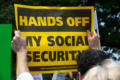 "Hundreds of progressive activists including Americans United for Change attended a rally held outside the Capitol Building in Washington DC on Thursday, July 28, 2011. The rally to ""Save the American Dream"" was organized to tell Democrats to stand strong against Republican debt ceiling proposals that cut Social Security, Medicare and Medicaid while keeping keep tax breaks for millionaires, billionaires and oil companies. Sign in photo reads ""Hands Off My Social Security"". Participants included the AFL-CIO and major labor unions such as AFSCME, CWA, AFGE, Teamsters, and various progressive groups such as Move-On, Rebuild the Dream, Jobs with Justice, Gray-Panthers and Code-Pink."