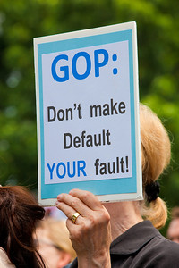 """GOP - Don't make Default YOUR fault"". Hundreds of progressive activists attended a rally held outside the Capitol Building in Washington DC on Thursday, July 28, 2011. The rally to ""Save the American Dream"" was organized to tell Democrats to stand strong against Republican debt ceiling proposals that cut Social Security, Medicare and Medicaid while keeping keep tax breaks for millionaires, billionaires and oil companies. Participants the AFL-CIO and major labor unions such as AFSCME, CWA, AFGE, Teamsters, and various progressive groups such as Move-On, Rebuild the Dream, Jobs with Justice, Gray-Panthers and Code-Pink."