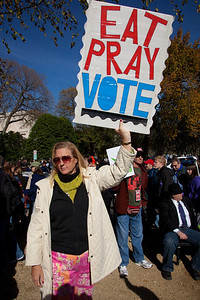 """Eat, Pray, Vote"". Imaginative protest signs were ubiquitous among the several hundred thousand who attended a ""Rally to Restore Sanity and/or Fear"" on the National Mall organized by Comedy Central talk show hosts Jon Stewart and Stephen Colbert  in Washington DC on Saturday, October 30, 2010. The rally took place only a few days before crucial mid-term elections that could tilt power in Congress toward the Republicans. (Photo by Jeff Malet)"