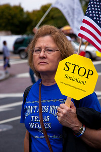 "A Tea Partier from the State of Texas marches on Pennsylvania Avenue in Washington DC for a second 9/12 rally on September 12, 2010. Her sign says ""Stop Socialism"". Here shirt warns ""Don't Mess With Texas Women"". (Photo by Jeff Malet)"