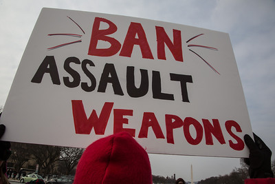 """""""Ban Assault Weapons"""" says this demonstrator. Approximately 100 residents from Newtown, Connecticut, the scene of a school massacre in which 20 children and six adults were killed last month, joined thousands of other anti gun violence activists on Saturday, January 26, 2013 in Washington D.C. in a march and rally on the National Mall in support of gun-control measures. (Photo by Jeff Malet)"""