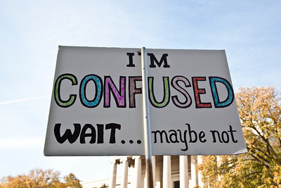"""I'm confusted. Wait.. Maybe not."" Imaginative protest signs were common among the several hundred thousand who attended a ""Rally to Restore Sanity and/or Fear"" on the National Mall organized by Comedy Central talk show hosts Jon Stewart and Stephen Colbert  in Washington DC on Saturday, October 30, 2010.  (Photo by Jeff Malet)"