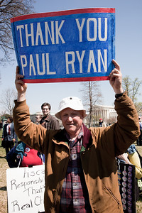"""Protestors thanks Rep. Paul Ryan (R-WI) at a noon """"Cut Spending Now Revolt"""" near the steps of the Capitol building in Washington DC to urge lawmakers to reduce federal spending. The Tea Party style rally was organized by Americans for Prosperity, a conservative, free-market group. Party leaders on Capitol Hill are racing to overcome an impasse in budget talks that is threatening a partial shutdown of the United States government.  Ryan just authored a ten year budget blueprint. April 6, 2011. (Photo by Jeff Malet)"""