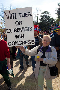 """Vote Tuesday or Extremists Win Congress"". Imaginative protest signs were aplenty among the several hundred thousand who attended a ""Rally to Restore Sanity and/or Fear"" on the National Mall organized by Comedy Central talk show hosts Jon Stewart and Stephen Colbert  in Washington DC on Saturday, October 30, 2010. The rally took place only a few days before crucial mid-term elections that could tilt power in Congress toward the Republicans. (Photo by Jeff Malet)"