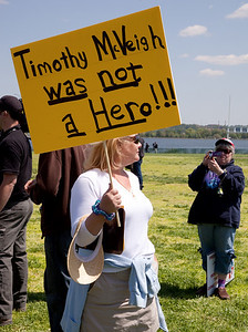"A lone counter-demonstrator amidst armed gun rights protestors at the ""Restore the Constitution"" gun rights rally at Gravelly Point Park on the Potomac River in Alexandria, VA. on April 19, 2010. The date also marked the 15th anniversary of the Oklahoma City bombing."