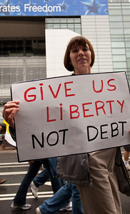 Home made signs spouting patriotic themes were abundant as Tea Partiers marched down Pennsylvania Avenue in Washington DC for a second 9/12 rally on September 12, 2010. The deficit and fiscal responsibility was a main theme of the protestors. (Photo by Jeff Malet)