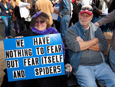 """We have nothing to fear but fear itself - and spiders"". Imaginative protest signs were ubiquitous among the several hundred thousand who attended a ""Rally to Restore Sanity and/or Fear"" on the National Mall organized by Comedy Central talk show hosts Jon Stewart and Stephen Colbert  in Washington DC on Saturday, October 30, 2010. (Photo by Jeff Malet)"