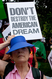 "Protestors demand ""Don't Destroy the American Dream"". Hundreds of progressive activists attended a rally held outside the Capitol Building in Washington DC on Thursday, July 28, 2011. The rally to ""Save the American Dream"" was organized to tell Democrats to stand strong against Republican debt ceiling proposals that cut Social Security, Medicare and Medicaid while keeping keep tax breaks for millionaires, billionaires and oil companies. Participants the AFL-CIO and major labor unions such as AFSCME, CWA, AFGE, Teamsters, and various progressive groups such as Move-On, Rebuild the Dream, Jobs with Justice, Gray-Panthers and Code-Pink."
