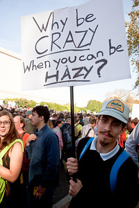 """Why be crazy when you can be hazy?. Imaginative protest signs were common among the several hundred thousand who attended a ""Rally to Restore Sanity and/or Fear"" on the National Mall organized by Comedy Central talk show hosts Jon Stewart and Stephen Colbert  in Washington DC on Saturday, October 30, 2010. (Photo by Jeff Malet)"