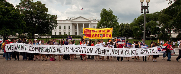 Arizona Governor Jan Brewer's visit to the White House sparked a protest against her state's tough law SB1070 which aims to identify, prosecute and deport illegal immigrants. The law would make the failure to carry immigration documents a crime and give the police broad power to detain anyone suspected of being in the country illegally. Opponents have called it an open invitation for harassment and discrimination against Hispanics regardless of their citizenship status. Washington DC -  June 3, 2010 (Photo by Jeff Malet)