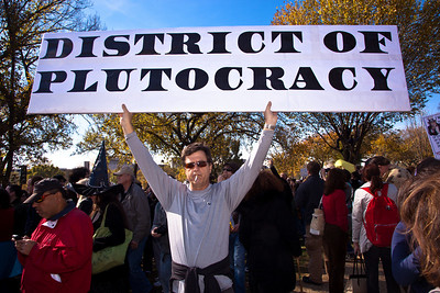 """District of Plutocracy"". Imaginative protest signs were ubiquitous among the several hundred thousand who attended a ""Rally to Restore Sanity and/or Fear"" on the National Mall organized by Comedy Central talk show hosts Jon Stewart and Stephen Colbert  in Washington in the District of Columbia on Saturday, October 30, 2010. (Photo by Jeff Malet)"