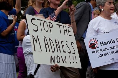 "Protestors demand ""Stop the Madness Now"". Hundreds of progressive activists attended a rally held outside the Capitol Building in Washington DC on Thursday, July 28, 2011. The rally to ""Save the American Dream"" was organized to tell Democrats to stand strong against Republican debt ceiling proposals that cut Social Security, Medicare and Medicaid while keeping keep tax breaks for millionaires, billionaires and oil companies. Participants the AFL-CIO and major labor unions such as AFSCME, CWA, AFGE, Teamsters, and various progressive groups such as Move-On, Rebuild the Dream, Jobs with Justice, Gray-Panthers and Code-Pink."