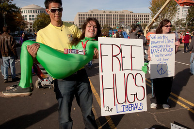 "Imaginative protest signs and demonstrations were common among the several hundred thousand who attended a ""Rally to Restore Sanity and/or Fear"" on the National Mall organized by Comedy Central talk show hosts Jon Stewart and Stephen Colbert  in Washington DC on Saturday, October 30, 2010.  Here someone has accepted her offer of ""Free hugs to liberals"". (Photo by Jeff Malet)"