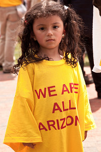 """We are all Arizona"". Protesters gather to speak out against stricter immigration laws, such as one passed recently in Arizona, at a May Day rally in Lafayette Square Park near the White House in Washington DC, May 1, 2010.  (Photo by Jeff Malet)"