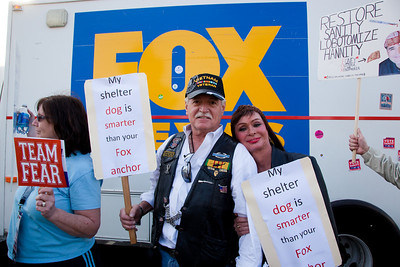 "Imaginative protest signs were common among the several hundred thousand who attended a ""Rally to Restore Sanity and/or Fear"" on the National Mall organized by Comedy Central talk show hosts Jon Stewart and Stephen Colbert  in Washington DC on Saturday, October 30, 2010. These protesters demonstrate against the conservative Fox News Network, here posing in front  of a Fox truck.  (Photo by Jeff Malet)"