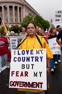 Home made signs were in abundance as Tea Partiers marched past the Federal Trade Commission Building on Pennsylvania Avenue in Washington DC for a second 9/12 rally on September 12, 2010. The focus was on the upcoming November 2nd Congressional elections where Republicans hope to take back the majority. (Photo by Jeff Malet)