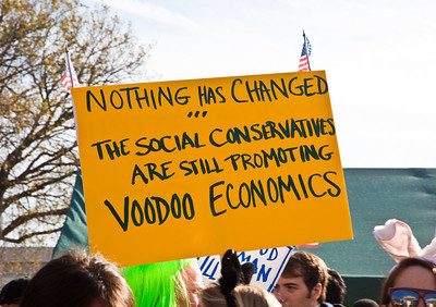 """Nothing has changed. The social conservatives are still promoting voodoo economics. Imaginative protest signs were ubiquitous among the several hundred thousand who attended a ""Rally to Restore Sanity and/or Fear"" on the National Mall organized by Comedy Central talk show hosts Jon Stewart and Stephen Colbert  in Washington DC on Saturday, October 30, 2010. This sign is a play against a comment made by George H.W. Bush during his campaign for president against Ronald Reagan when he diminished the idea that tax cuts can generate higher tax revenue resulting from the attendant grwoth of the economy. This concept is often refered to as sell side economics. (Photo by Jeff Malet)"