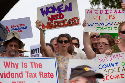 """Women Need Medicaid"" declares activists attending a rally held outside the Capitol Building in Washington DC on Thursday, July 28, 2011. The rally to ""Save the American Dream"" was organized to tell Democrats to stand strong against Republican debt ceiling proposals that cut Social Security, Medicare and Medicaid while keeping keep tax breaks for millionaires, billionaires and oil companies. Participants the AFL-CIO and major labor unions such as AFSCME, CWA, AFGE, Teamsters, and various progressive groups such as Move-On, Rebuild the Dream, Jobs with Justice, Gray-Panthers and Code-Pink."