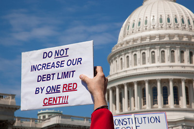 "Protestors demand ""Do not increase our debt limit by one red cent"" at a noon ""Cut Spending Now Revolt"" on the steps of the Capitol building in Washington DC to urge lawmakers to reduce federal spending. The Tea Party style rally was organized by Americans for Prosperity, a conservative, free-market group. Party leaders on Capitol Hill are racing to overcome an impasse in budget talks that is threatening a partial shutdown of the United States government. April 6, 2011. (Photo by Jeff Malet)"