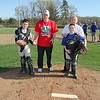 After the ceremonial first pitch of the Leominster American Little League in April 2012, the catchers and the honorees gathered on the mound for a picture. From left is Whittons catcher Sean Kenney and Vern Brideau along with Sport Photography's catcher Andrew LeBlanc, 9, and Ward 2 councilor Wayne Nickel.<br /> SENTINEL & ENTERPRISE / JOHN LOVE