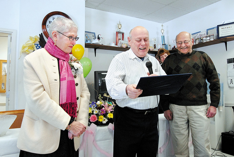 Joan Fitzgerald is recognized by Wayne Nickel, Council President and Jim Lanciani, Council Vice President for her 21 years of service as the Director of the Council on Aging during her retirement party at the Leominster Senior Center in February 2009.<br /> SENTINEL & ENTERPRISE / BRETT CRAWFORD