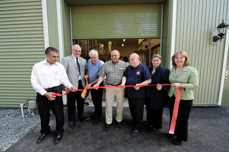 From left, Mayor Dean Mazzarella, Keavin Nelson, President of Veolia Water, Councilor Bob Salvatelli, Councilor at-large James Lanciani, Councilor Wayne Nickel, Councilor Claire Freda, and Councilor at-large Susan Chalifoux-Zephir, and Councilor Claire Freda, during the ribbon cutting for the new filtration plant at the Distributing Reservoir in Leominster in May 2010.<br /> SENTINEL & ENTERPRISE / BRETT CRAWFORD