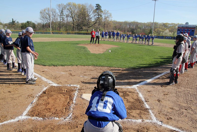 SENTINEL & ENTERPRISE / JOHN LOVE<br /> Ward 2 City Councilor Wayne Nickel throws out the first pitch to Sport Photography's team catcher Andrew LeBlanc, 9, as the Leominster American Little League opens its season in April 2012. With Nickel is Vern Brideau. <br /> SENTINEL & ENTERPRISE / JOHN LOVE