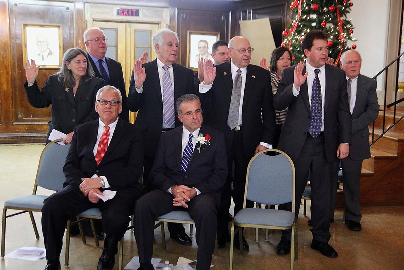 Ward 2 Councilor Wayne Nickel, back right, is sworn in with fellow councilors, standing from left, Claire Freda, Richard Marchand, Robert Salvatelli, David Cormier, James Lanciani, Gail Feckley and John Dombrowski in 2014 at City Hall. SENTINEL & ENTERPRISE/JOHN LOVE
