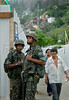 Army soldiers patrol as residents go out of a polling station during municipal elections in Rocinha slum, Rio de Janeiro, Brazil, October 5, 2008. Nearly 130 million voters were called up for the elections, which will select mayors and councillors for the country's 5,563 towns and cities. (Austral Foto/Renzo Gostoli)