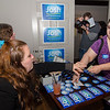 Amanda Maher purchases a sticker and keychain during the campaign kickoff event for State Representative candidate Josh Sanderski at 435 Bar and Grille in Leominster on Tuesday evening. SENTINEL & ENTERPRISE / Ashley Green