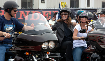 Sarah Palin made an appearance at the annual Rolling Thunder motorcycle rally along with members of her family. Sarah rides behind daughter Willow on the right. Piper Palin (unseen) rides behind father Todd on the left. Here appearing at the Pentagon parking lot for the traditional noon time start. In Washington DC on May 29, 2011. (Photo by Jeff Malet)