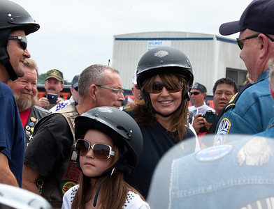 Sarah Palin (center) made an appearance at the annual Rolling Thunder motorcycle rally along with husband Todd Palin (left) and daughter Piper. Here appearing at the Pentagon parking lot for the traditional noontime start. In Washington DC on May 29, 2011.  (Photo by Jeff Malet)