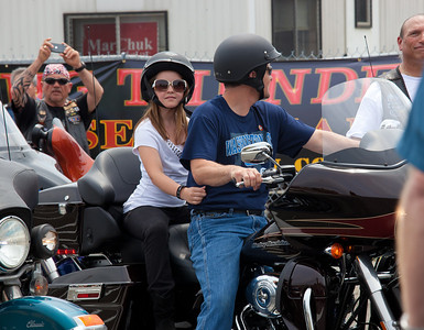 Piper Palin rides behind father Todd. Sarah Palin made an appearance at the annual Rolling Thunder motorcycle rally along with members of her family. Here appearing at the Pentagon parking lot for the traditional noon time start. In Washington DC on May 29, 2011.  (Photo by Jeff Malet)