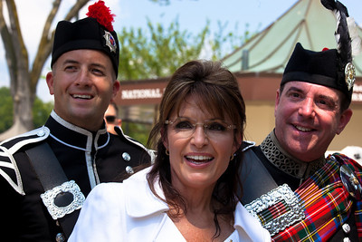 "Sarah Palin with two members of the Montgomery County Firefighters Pipe Band Inc. who performed near the Lincoln Memorial for Glenn Beck's ""Restoring Honor"" rally in Washington DC on August 28, 2010. The pipers are Russel Blinkhorn and Dave Madock.  (Photo by Jeff Malet)"