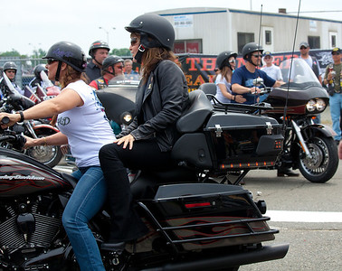 Sarah Palin made an appearance at the annual Rolling Thunder motorcycle rally along with members of her family. Sarah rides behind daughter Willow. Todd and Piper Palin appear in the rear. Here appearing at the Pentagon parking lot for the traditional noontime start. In Washington DC on May 29, 2011.  (Photo by Jeff Malet)