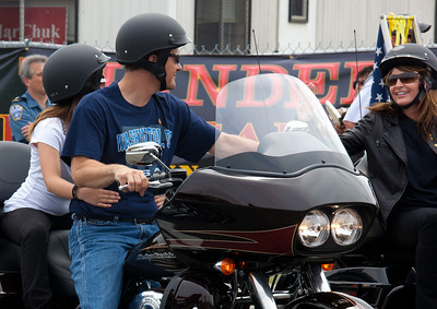 Sarah Palin made an appearance at the annual Rolling Thunder motorcycle rally along with members of her family. Sarah rides behind daughter Willow (unseen) on the right. Piper Palin rides behind father Todd on the left. Here appearing at the Pentagon parking lot for the traditional noon time start. In Washington DC on May 29, 2011. (Photo by Jeff Malet)