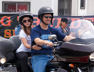 Piper Palin rides behind father Todd. Sarah Palin made an appearance at the annual Rolling Thunder motorcycle rally along with members of her family. Here appearing at the Pentagon parking lot for the traditional noontime start. In Washington DC on May 29, 2011.  (Photo by Jeff Malet)