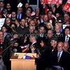 """New socialist Seattle City Council member Kshama Sawant speaking during inauguration 1/6/2014. Signs in back for campaign to raise the minimum wage to $15/hr, a major demand of her campaign. The signs are from a new organization started around the issue called """"15 Now"""".<br /> <br />  <a href=""""http://www.15now.org"""">http://www.15now.org</a>"""