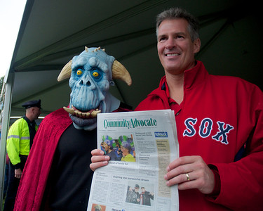 092912, Shrewsbury, MA - Sen. Scott Brown holds a copy of the local Community Advocate along side a monstrous supporter at the Spirit of Shrewsbury festival on Friday. Herald photo by Ryan Hutton