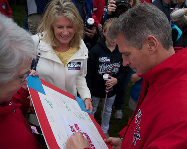 092912, Shrewsbury, MA - Sen. Scott Brownsigns a poster with notes of support from Shrewsbury residents at the Spirit of Shrewsbury festival on Friday. Herald photo by Ryan Hutton