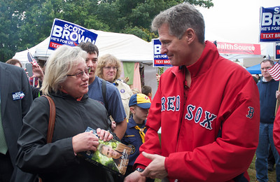 092912, Shrewsbury, MA - Sen. Scott Brownsigns a copy of his book for a supporter at the Spirit of Shrewsbury festival on Friday. Herald photo by Ryan Hutton