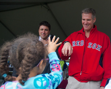 092912, Shrewsbury, MA - Sen. Scott Brown jokes with a little girl whose face was painted like a cheetah at the Spirit of Shrewsbury festival on Friday. Herald photo by Ryan Hutton