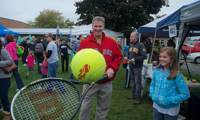 092912, Shrewsbury, MA - Sen. Scott Brown plays with a giant tennis racket and ball at the Spirit of Shrewsbury festival on Friday. Herald photo by Ryan Hutton