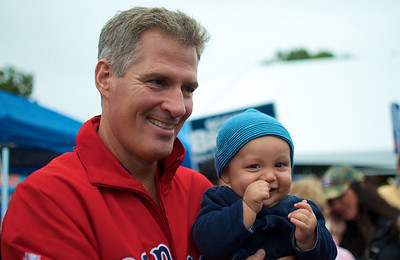 092912, Shrewsbury, MA - Sen. Scott Brown holds nine-month-old Solomon Molina at the Spirit of Shrewsbury festival on Friday. Herald photo by Ryan Hutton